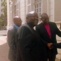 Bishop Chad Gandiya (centre) smiling after winning the ownership of Anglican Church property case in the Harare today. The Supreme Court decision ended the six-year dispute between  led by him  Anglicans and Nolbert Kunonga's Church of the Province of Zimbabwe.  In the background: Dr Julius Makoni of Manicaland and Registrar of the Anglican Church, Michael Chigore, who served as lawyer representing Bishop Gandiya in the court. (Photo M. Chibaya)