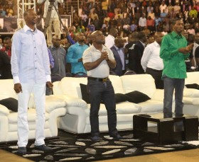 Spiritual godfather Victor Boateng, a Ghanaian preacher flanked by Zimbabwe's charismatic celebrity preachers Prophets Emmanuel Makandiwa (left) and Uebert Angel (right) during the opening of a 2-day ManWorld Convention at the City Sports Centre in Harare. (photo: M Chibaya).