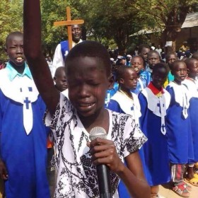 These are kids praying for peace in southern Sudan. They are just tired of seeing their parents being killed out of political violence.Children need peace to develop and grow. (photo: by Chrissmedia).