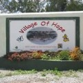 Foto of Village of Hope sign