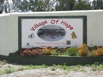 Foto of Village of Hope sign